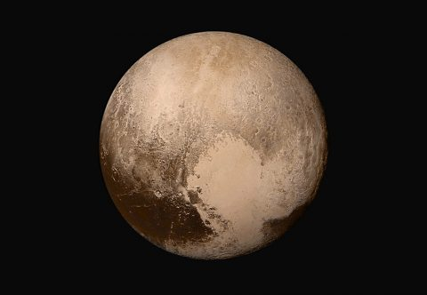 Four images from New Horizons' Long Range Reconnaissance Imager (LORRI) were combined with color data from the Ralph instrument to create this global view of Pluto. The images, taken when the spacecraft was 280,000 miles (450,000 kilometers) away from Pluto, show features as small as 1.4 miles (2.2 kilometers). (NASA/JHUAPL/SwRI)