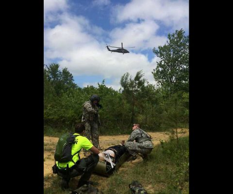 Soldiers of the Tennessee Army National Guard work with a Tennessee State Park Ranger to prepare a crash victim for extraction and transport to an area hospital. This was one of multiple simulated events as part of Tennessee Maneuvers 2016. (Clint Derryberry with Maury County Search and Rescue)