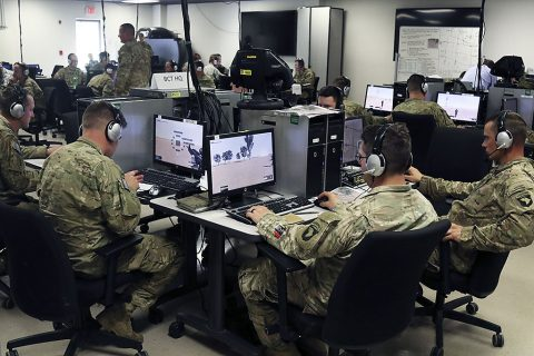"Company commanders with 1st Brigade Combat Team, 101st Airborne Division (Air Assault), fill the role of brigade staff as they conduct a notional brigade assault using the Virtual Battlespace System at the Kinnard Mission Training Complex, Fort Campbell, Ky. May 24, 2016. The assault was the final part of a two-day training exercise, meant to mirror a mungadai and build esprit de corps throughout the company commanders within ""Bastogne"". (Sgt. Samantha Stoffregen, 1st Brigade Combat Team, 101st Airborne Division (Air Assault) Public Affairs)"