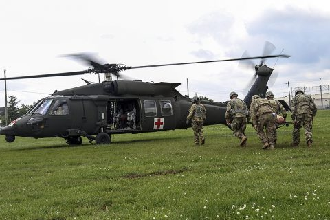 Medics with 1st Brigade Combat Team, 101st Airborne Division (Air Assault) litter carry a simulated casualty to a waiting UH-60 Blackhawk on Johnson field during the brigade's Expert Field Medical Badge train-up May 26, 2016. Soldiers practiced loading causalities while the aircraft's rotor wings continue to spin because it will be one of more than 200 tasks they are tested on at the end of June. (Sgt. Samantha Stoffregen, 1st Brigade Combat Team, 101st Airborne Division (Air Assault) Public Affairs)