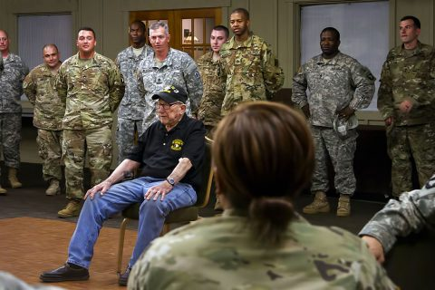 "Retired Army Capt. Clause ""Dutch"" Mann, a 92 year old World War II and Korean War veteran, speaks to the senior noncommissioned officers of the 101st Airborne Division Sustainment Brigade, 101st Airborne Division (Air Assault), during their NCO call at the Smokehouse on Fort Campbell, Ky., June 15, 2016. (Sgt. Neysa Canfield)"