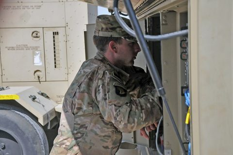 Spc. Sean Luoma, a systems operator/maintainer in Company C, 39th Brigade Engineer Battalion, Task Force Strike, checks his satellite communications equipment, May 20, 2016, in Erbil, Iraq. Luoma and other signal Soldiers deployed with Task Force Strike to ensure the more than 1,300 personnel of the Task Force can communicate throughout their area of Operations. (1st Lt. Daniel Johnson)