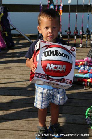 This little boy won a basketball.