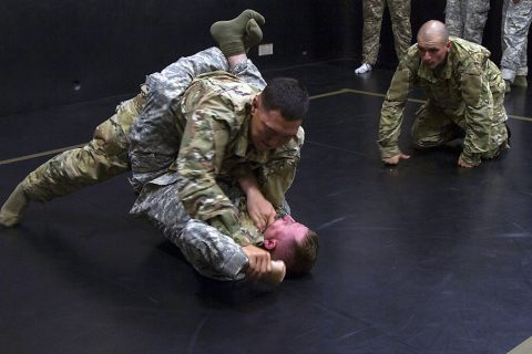 Sergeant Stewart J. Thomas, a multichannel transmission systems operator with 58th Signal Company, 101st Special Troops Battalion, 101st Airborne Division Sustainment Brigade, 101st Airborne Division, pins down his opponent May 19 during a combatives tournament which was part the Best Spartan competition. (Sgt. Neysa Canfield, 101st Airborne Division Sustainment Brigade Public Affairs)