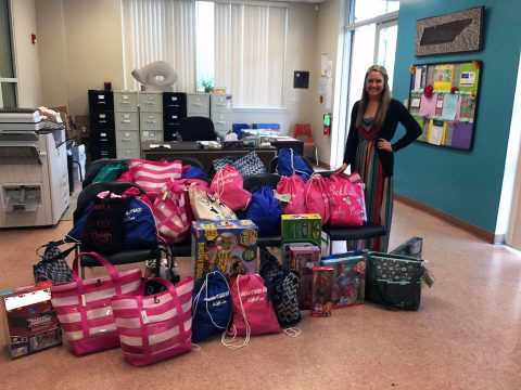 Bekkah Eaves with the bags she donated to the Montgomery County Safehouse.