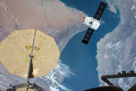The SpaceX Dragon spacecraft nears the International Space Station during the CRS-8 mission to deliver experiments including two microbial investigations. (NASA)
