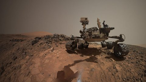 """This low-angle self-portrait of NASA's Curiosity Mars rover shows the vehicle at the site from which it reached down to drill into a rock target called """"Buckskin."""" Bright powder from that July 30, 2015, drilling is visible in the foreground. (NASA/JPL-Caltech/MSSS)"""