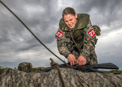 2nd Lt. Leah Mullenix, Team 23, 326th Brigade Engineer Battalion, 1st Brigade Combat Team, 101st Airborne Division (Air Assault), disassembles her poncho team's raft after completing the swim event of the Best Sapper Competition at Fort Leonard Wood, Mo., April 19, 2016. Sappers pulled a raft carrying their individual weapon and full ruck sack. Mullenix was the first female, Army-wide, to complete the three-day competition and place in the top ten teams. (U.S. Army photo courtesy of Fort Leonardwood Public Affairs)