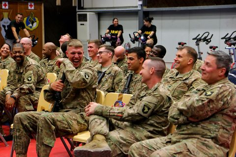 Combined Joint Forces Land Component Command – Operation Inherent Resolve service members laugh at jokes during the Star Spangled Comedy Tour at the Eagle Fitness Center, Forward Operating Base Union III, Baghdad, June 21, 2016. The tour, organized by Armed Forces Entertainment, featured comedians Stephen Thomas, Sam Fedele and Steve Mazan (not pictured), who performed in Iraq for four days. Other shows were performed in Erbil, Camp Taji and at the Baghdad Diplomatic Support Center. (Sgt. Katie Eggers)