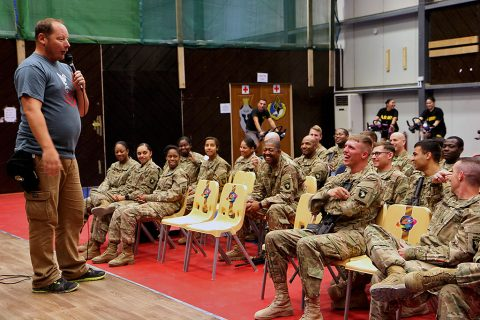 Comedian and Navy veteran Steve Mazan tells a joke to a group of service members deployed to Iraq as part of the Combined Joint Forces Land Component Command – Operation Inherent Resolve at the Eagle Fitness Center, Forward Operating Base Union III, Baghdad, June 21, 2016. Mazan co-headlined the Star Spangled Comedy Tour, organized by Armed Forces Entertainment, with comedians Stephen Thomas and Sam Fedele (not pictured). (Sgt. Katie Eggers)