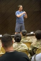 Comedian Stephen Thomas performs for a group of service members deployed to Iraq as part of the Combined Joint Forces Land Component Command – Operation Inherent Resolve at the Eagle Fitness Center, Forward Operating Base Union III, Baghdad, June 21, 2016. Thomas co-headlined the Star Spangled Comedy Tour, organized by Armed Forces Entertainment, with comedians Sam Fedele and Steve Mazan (not pictured). (Sgt. Katie Eggers)