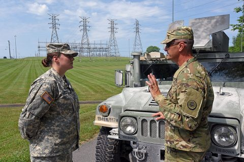 Maj. Gen. Jeffrey H. Holmes, deputy adjutant general for the Tennessee National Guard, receives an update from 1st Lt. Sabrina Rumpf, officer in charge of securing the facility and platoon leader with the 269th Military Police Company, 117th Military Police Battalion, 194th Engineer Brigade, during a security assistance exercise to protect the Old Hickory Dam Powerhouse and Switchyard in Hendersonville, Tenn., June 20, 2016. (USACE photo by Leon Roberts)