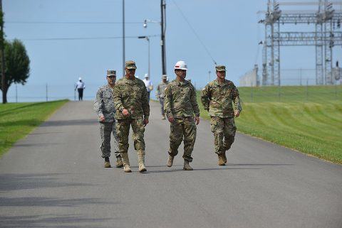 Corps of Engineers and Tennessee National Guard officials escort Maj. Gen. Jeffrey H. Holmes, deputy adjutant general for the Tennessee National Guard, to a security checkpoint at the Old Hickory Dam during a site visit to the facility during a security assistance exercise in Hendersonville, Tenn., June 20, 2016. The general visited soldiers participating in the exercise and received an update from the platoon leader in charge of protecting the power plant and switchyard. (USACE photo by Mark Rankin)