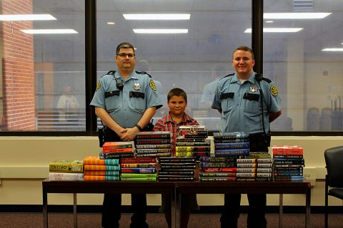 9 year old Tyler Fugett donated over 100 books to the Montgomery County Jail library.