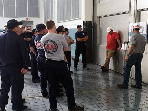 U.S. Army Corps of Engineers Nashville District employees, Ashland City Fire Department fire fighters, and Dickson County Fire Department fire fighters learn about the layout of the Cheatham Dam Powerhouse during a confined space rescue training exercise at the facility in Charlotte, Tennessee, May 24, 2016. (USACE photo by Josh Lowery)