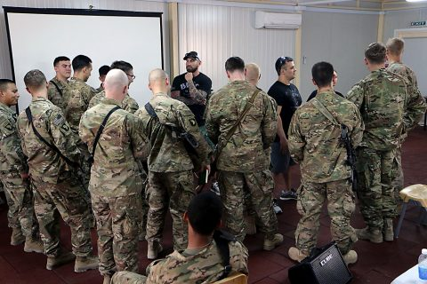 """Mat Best, left, CEO of Article 15 Clothing and Army Ranger veteran, and Nick Palmisciano, founder of Ranger Up clothing company and Army veteran, talk with a group of Combined Joint Forces Land Component Command – Operation Inherent Resolve Soldiers after a viewing of their movie, """"Range 15,"""" at Forward Operating Base Union III, Baghdad, July 10, 2016. (U.S. Army photo by Sgt. Katie Eggers)"""