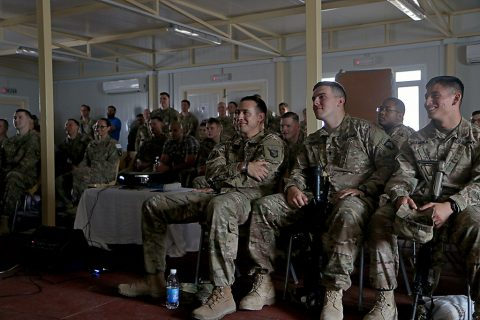 """Combined Joint Forces Land Component Command – Operation Inherent Resolve service members watch the movie """"Range 15"""" at Forward Operating Base Union III, Baghdad, July 10, 2016. After the movie, service members had a meet and greet with stars of the movie, Mat Best, CEO of Article 15 Clothing and Army Ranger veteran, Nick Palmisciano, founder of Ranger Up clothing company and Army veteran, and Jarred Taylor, Article 15's chief marketing officer and Air Force veteran. (U.S. Army photo by Sgt. Katie Eggers)"""