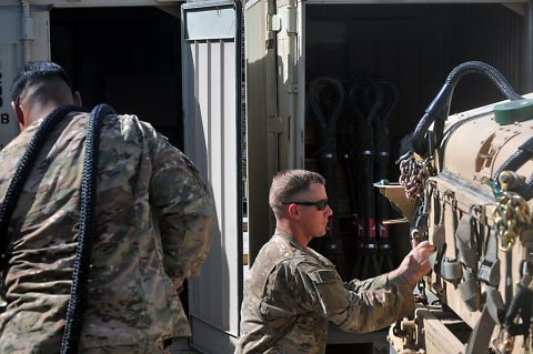 Sgt. Robert Rojas, left, and Staff Sgt. Thomas Gardner, right, with the 526th Brigade Support Battalion, Task Force Strike, prepare an M1151 Humvee for sling load operations July 15, 2016, in Taji, Iraq. The 526th BSB is the base operating support integrator for Coalition forces on Camp Taji, responsible for integrating the operations of Coalition forces with the Iraqi security forces. (1st Lt. Daniel Johnson)