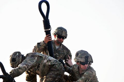 A hook-up team, consisting of Soldiers with 1st Battalion, 26th Infantry Regiment, Task Force Strike, prepare an M1151 Humvee for sling load operations, July 16 2016, in Taji, Iraq. The Soldiers conducted the training to maintain their proficiency in sling load operations while deployed to Iraq in support of Operation Inherent Resolve. (1st Lt. Daniel Johnson)