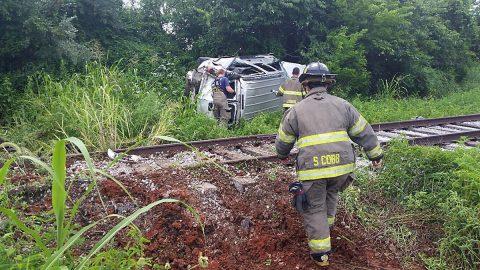 EMS works a rollover accident on Jack Miller Boulevard.