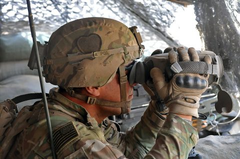 Sgt. Arturro Hernandez of Apache Troop, 1st Squadron, 75th Cavalry Regiment, Task Force Strike, looks through his binoculars during his guard shift June 18th, 2016, at Kara Soar Base, Iraq. Part of Troop A's mission is protecting the artillery responsible for the fires at the Kara Soar Base. The fires at the Kara Soar Base serve two roles: force protection for Coalition and Iraqi security forces and fire in support of maneuver, enabling ISF to defeat Daesh. (1st Lt. Daniel Johnson)