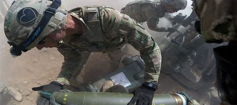 Staff Sergeant Carlos Mont with Battery C, 1st Battalion, 320th Field Artillery Regiment, Task Force Strike, inspects a round during a fires mission in Kara Soar, Iraq, June 10, 2016. As crew chief Mont is responsible for the safety of all personnel on the gun during firing. The fire missions at the Kara Soar Base serve two roles: to provide force protection for Coalition and Iraqi security forces and to support the Iraqi Security forces ground maneuver by providing indirect fire support, enabling them to defeat Da'esh. (U.S. Army photo by 1st Lt. Daniel Johnson/Released)