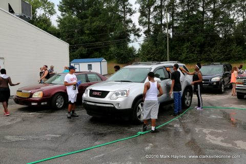 LEAP Youth working hard at their Car Wash Friday.