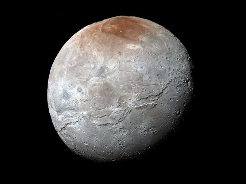 NASA's New Horizons spacecraft captured this high-resolution enhanced color view of Pluto's moon Charon just before closest approach on July 14, 2015. Charon's striking reddish north polar region is informally named Mordor Macula.(NASA/JHUAPL/SwRI)