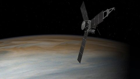 This artist's concept depicts the Juno spacecraft above Jupiter. The spacecraft will next fly by the planet on Aug. 27th, in the mission's first up-close science pass. (NASA/JPL-Caltech)