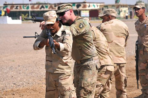 U.S. Army Staff Sgt. Brandon Blanton, center, a trainer with Company A, 1st Battalion 502nd Infantry Regiment, Task Force Strike, assists Iraqi army ranger students during a room clearing drill at Camp Taji, Iraq July 18, 2016. Students were first instructed as a whole by their leadership, then broken into small groups for practice. Camp Taji is one of four Combined Joint Task Force – Operation Inherent Resolve build partner capacity locations dedicated to training Iraqi security forces. (U.S. Army photo by 1st Lt. Daniel Johnson/Released)
