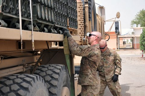 Staff Sgt. Jared Leach, left, and Sgt. Maj. Paul Rick, right, with 1st Battalion, 67th Armor Regiment, Task Force Dealer, help prepare ammunition provided by Iraq Train and Equip Funding for distribution to members of the 9th Iraqi Army Division, June 27, 2016, in Taji, Iraq. (1st Lt. Daniel Johnson/Released)