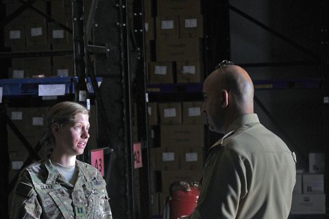 Capt. Shige Clark with Headquarters and Headquarters Company, 526th Brigade Support Battalion, speaks to her Iraqi counterpart about the layout and procedures of a medical supply storage facility July 12, 2016, in Taji, Iraq. The 5256th BSB and other coalition forces on Camp Taji are advising the Iraqi security forces on logistics programs and procedures. (1st Lt. Daniel Johnson/Released)
