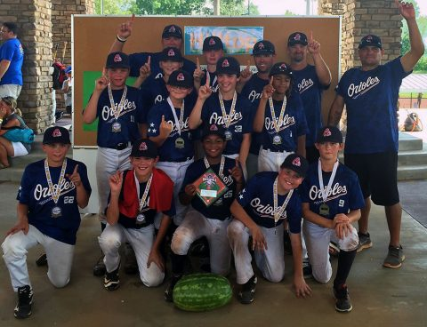 The Clarksville Orioles-11U team won the 12U division at the Hilltop Super Market Moving-Up travel ball tournament.