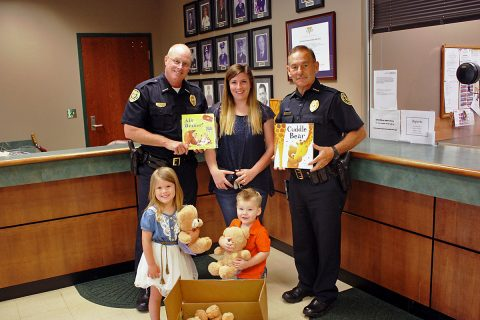 Deputy Chief Parr and Deputy Chief Gray are pictured with Mrs. Glynn and her two children.
