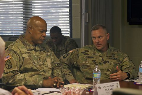 Col. Stanley Sliwinski (right), commander for the 101st Airborne Division Sustainment Brigade, discusses future logistic operations with Lt. Gen. Larry D. Wyche, deputy commanding general for United States Army Material Command, during Wyche's visit to Fort Campbell, Ky., Aug. 9, 2016. (Sgt. Neysa Canfield, 101st Airborne Division Sustainment Brigade Public Affairs)