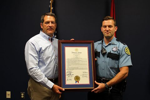 Tennessee State Senator Mark Green presents MCSO Deputy Ethan Moss with Tennessee Senate Joint Resolution.