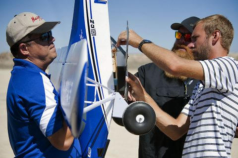 Derek Abramson, from left, Justin Hall, and Alexander Frock position the Prandtl-M glider aircraft onto the Carbon Cub that drops it from 500 feet altitude. (NASA Photo / Lauren Hughes)