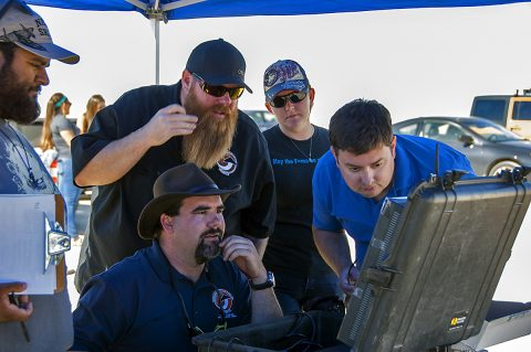Jonathan Adams, from left, John Bodylski, Justin Hall, Caitlin Kennedy and Dave Berger watch a computer screen providing the Prandtl-M's exact location and altitude. (NASA Photo / Kyria Luxon)