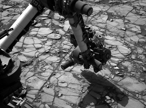 "NASA's Curiosity Mars rover began close-up investigation of a target called ""Marimba,"" on lower Mount Sharp, during the week preceding the fourth anniversary of the mission's Aug. 6, 2016, landing. Curiosity's Navigation Camera took this shot of the rover's arm over Marimba on Aug. 2, 2016. (NASA/JPL-Caltech/MSSS)"
