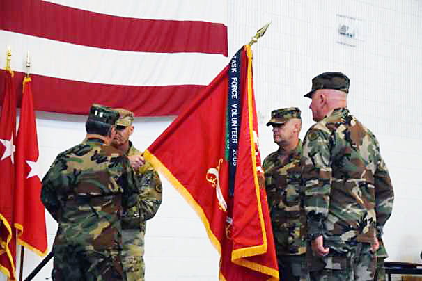 Brig. Gen. Kenneth Takasaki (L) relinquishes the colors to Brig. Gen. Tommy Baker, Assistant Adjutant General-Army, Tennessee National Guard (2nd from left) prior to transferring them to Brig. Gen. Craig Johnson (2nd from right). (Staff Sgt. Tim Belcher, Joint Public Affairs, Tennessee National Guard)