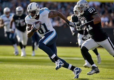 Tennessee Titans wide receiver Andre Johnson (81) runs with the ball after making a catch against the Oakland Raiders in the first quarter at Oakland Alameda Coliseum. (Cary Edmondson-USA TODAY Sports)