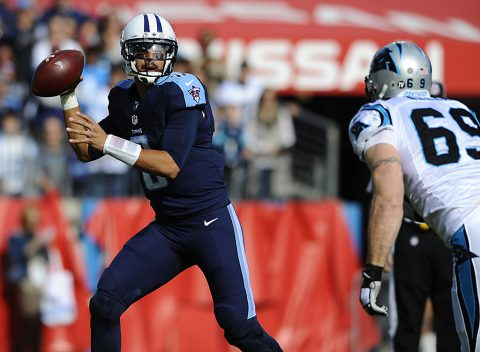 Tennessee Titans quarterback Marcus Mariota (8) rolls out of the pocket chased by Carolina Panthers defensive end Jared Allen (69) during the first half at Nissan Stadium. (Christopher Hanewinckel-USA TODAY Sports)