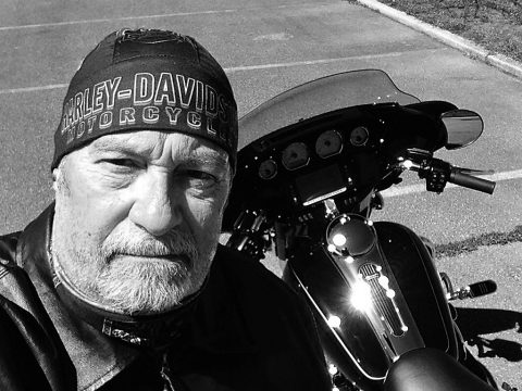 Hank Bonecutter with his Harley Davidson