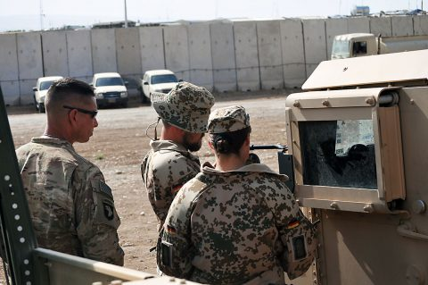 1st Sgt. John Wilkerson, left, the senior noncommissioned officer for Headquarters and Headquarters Company, 2nd Battalion, 502nd Infantry Regiment, Task Force Strike, works with members of the German contingent on a Humvee , in Erbil, Iraq, June 22, 2016. U.S. and German soldiers from Combined Joint Land Forces Component Command - Operation Inherent Resolve assisted in teaching a driver's training class to Peshmerga forces. (1st Lt. Daniel Johnson/Released)