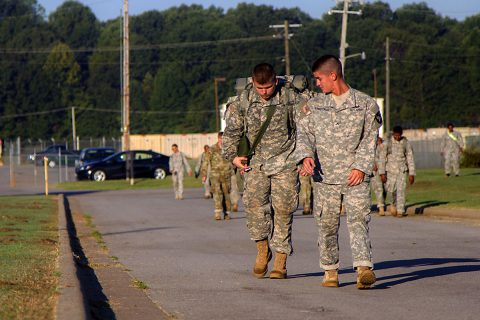 Pvt. Trevor L. Arbuckle (right), a small arms and artillery repairer with 584th Support Maintenance Company, 129th Combat Sustainment Support Battalion, 101st Airborne Division (Air Assault) Sustainment Brigade, 101st Abn. Div., helps motivate his partner during the last half mile of a four-mile ruck march, Sept. 20, 2016, during the Burden Bearer Challenge on Fort Campbell, Ky. (Sgt. Neysa Canfield/101st Airborne Division Sustainment Brigade Public Affairs)