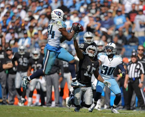 Tennessee Titans inside linebacker Avery Williamson (54) intercepts a pass intended for Oakland Raiders wide receiver Michael Crabtree (15) during the second half at Nissan Stadium. The Raiders defeated the Titans 17-10. (Kirby Lee-USA TODAY Sports)