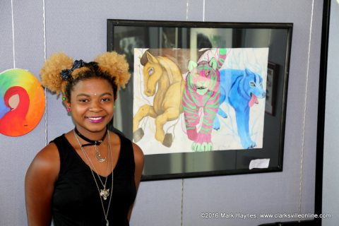 Brianah Summons won 1st place in the High School Art Show with her painting of animals.