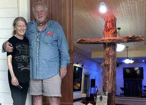 Sally and Brian Oxley and their rugged old cross.