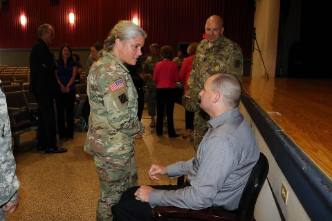 WTB Command Sgt. Maj. Staci Rea thanked Cpl. Matthew Bradford following the telling of his personal story of overcoming amputations and blindness. Soldiers stood in line to share their appreciation as Bradford met and spoke to them one-on-one following his inspirational talk of not giving up.