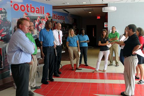 APSU Athletic Director Ryan Ivey addresses some members of the TSSAA delegation in the Fortera Stadium locker room. Pictured left to right are: TSSAA Assistant Executive Director Mark Reeves, Executive Director Bernard Childress, TSSAA Technology Director Bradley Lambert, APSU Athletic Director Ryan Ivey, and TSSAA Assistant Executive Director Richard McWhirter.